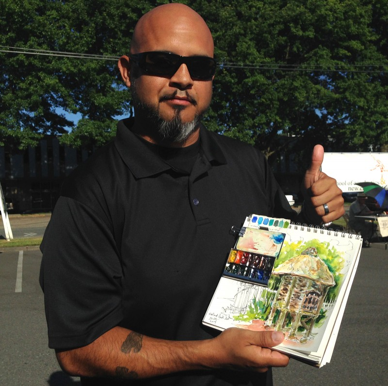 Artist Che Lopez with his Pocket Palette and sketchbook